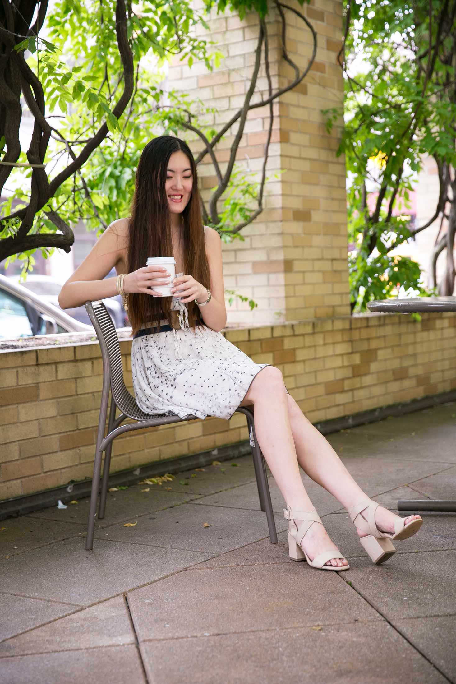 Wearing a smile with little white dress in West village